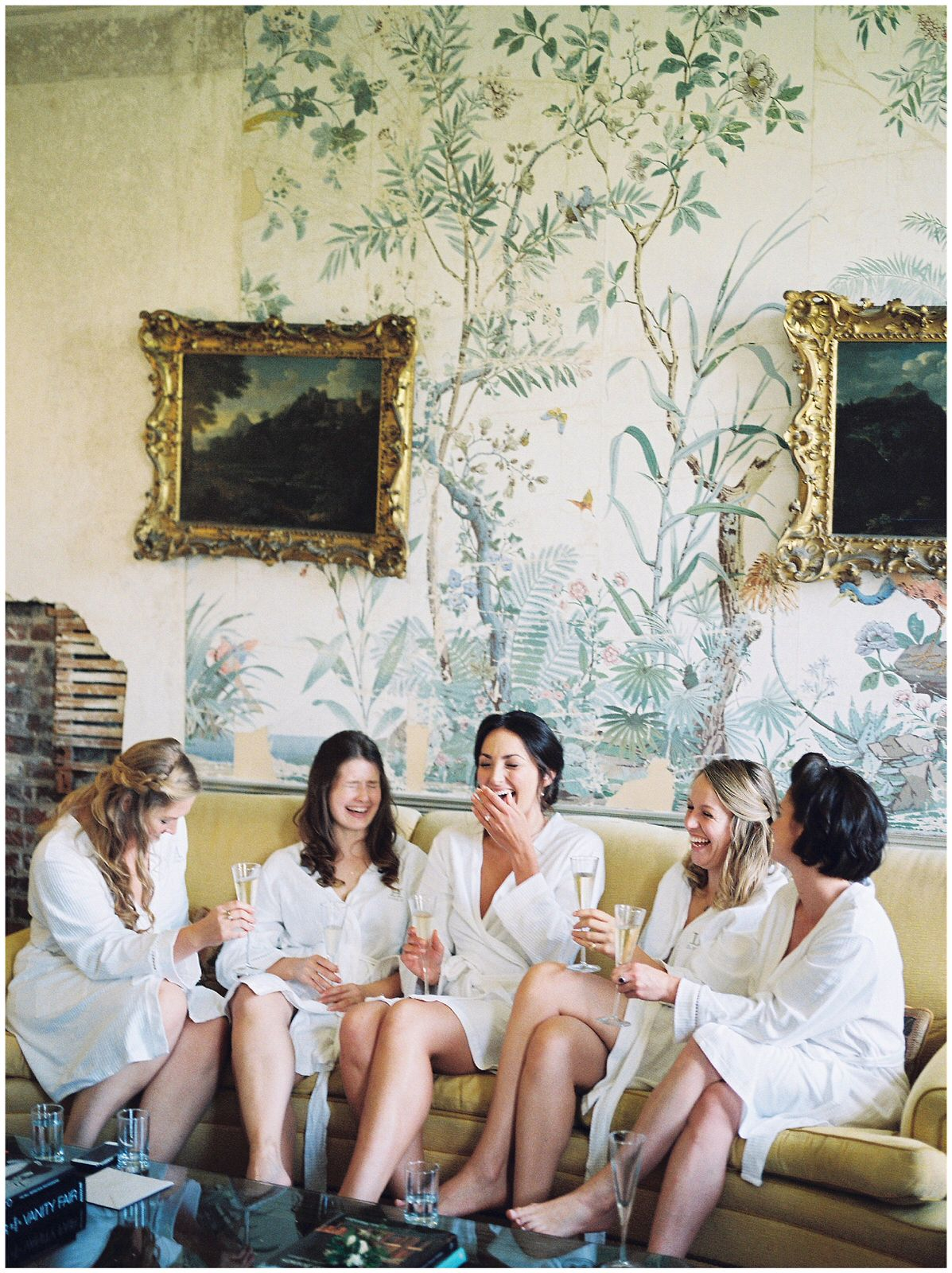 GIGGLING BRIDESMAIDS IN THE ST GILES HOUSE BRIDAL SUITE