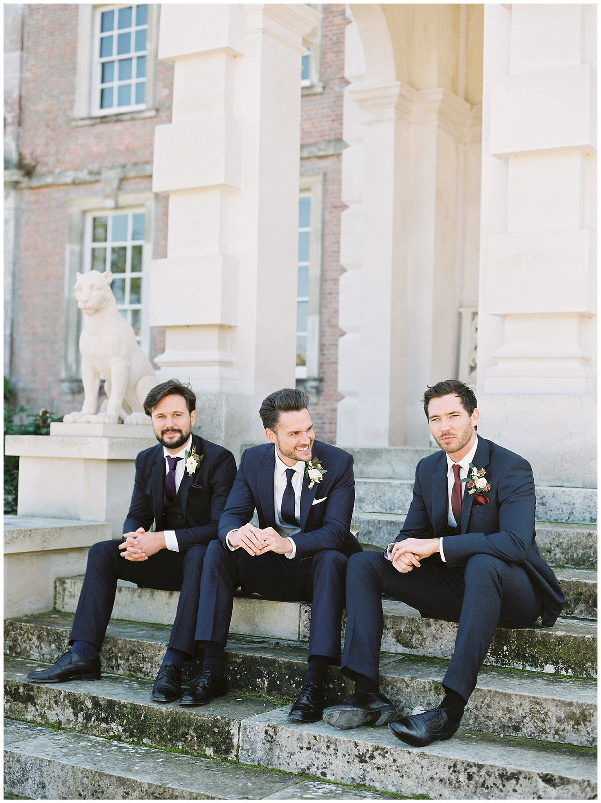 groom and his best men sat outside st giles house in dorset