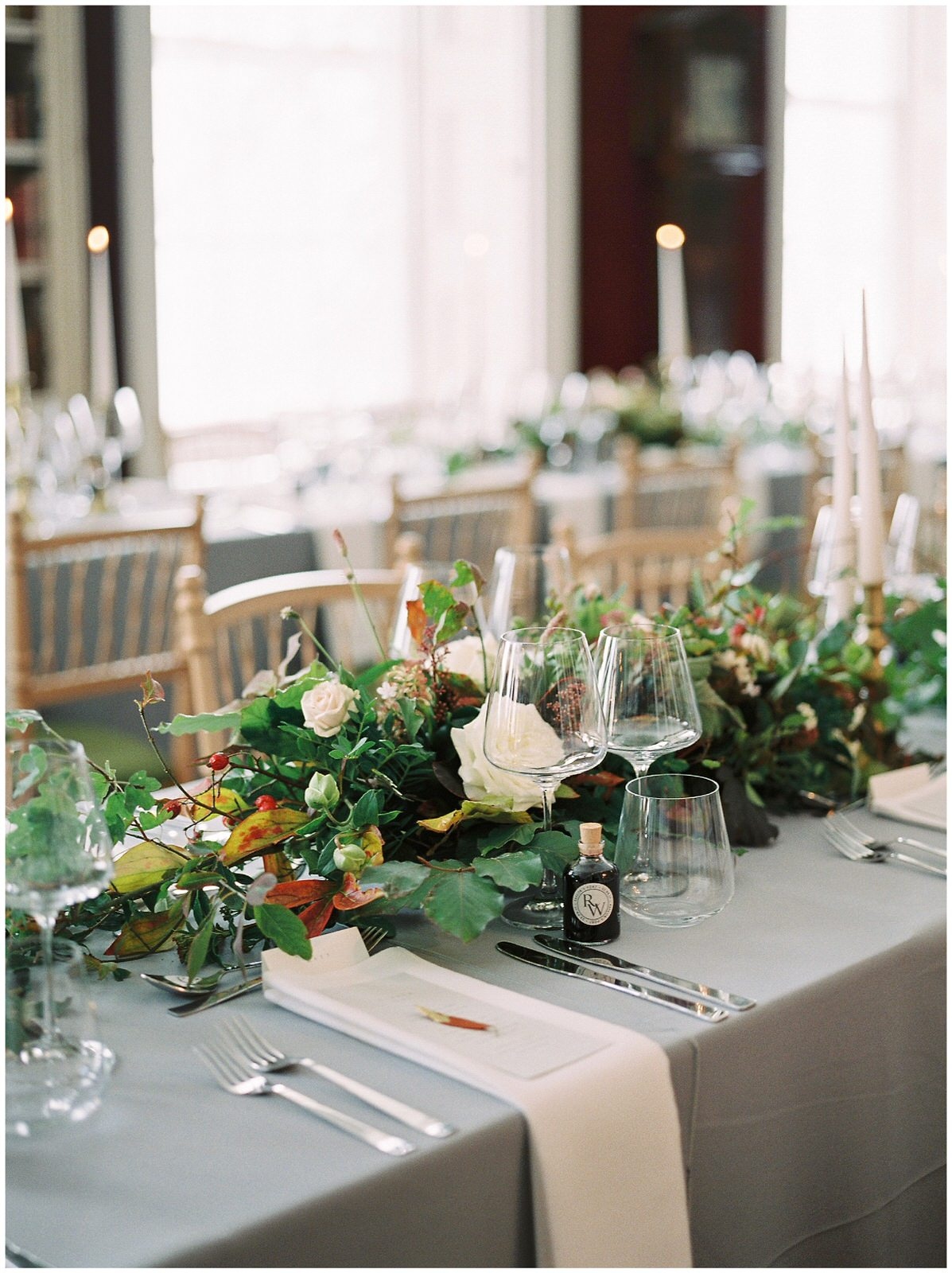 gold and grey wedding tables with autumn flower arrangments