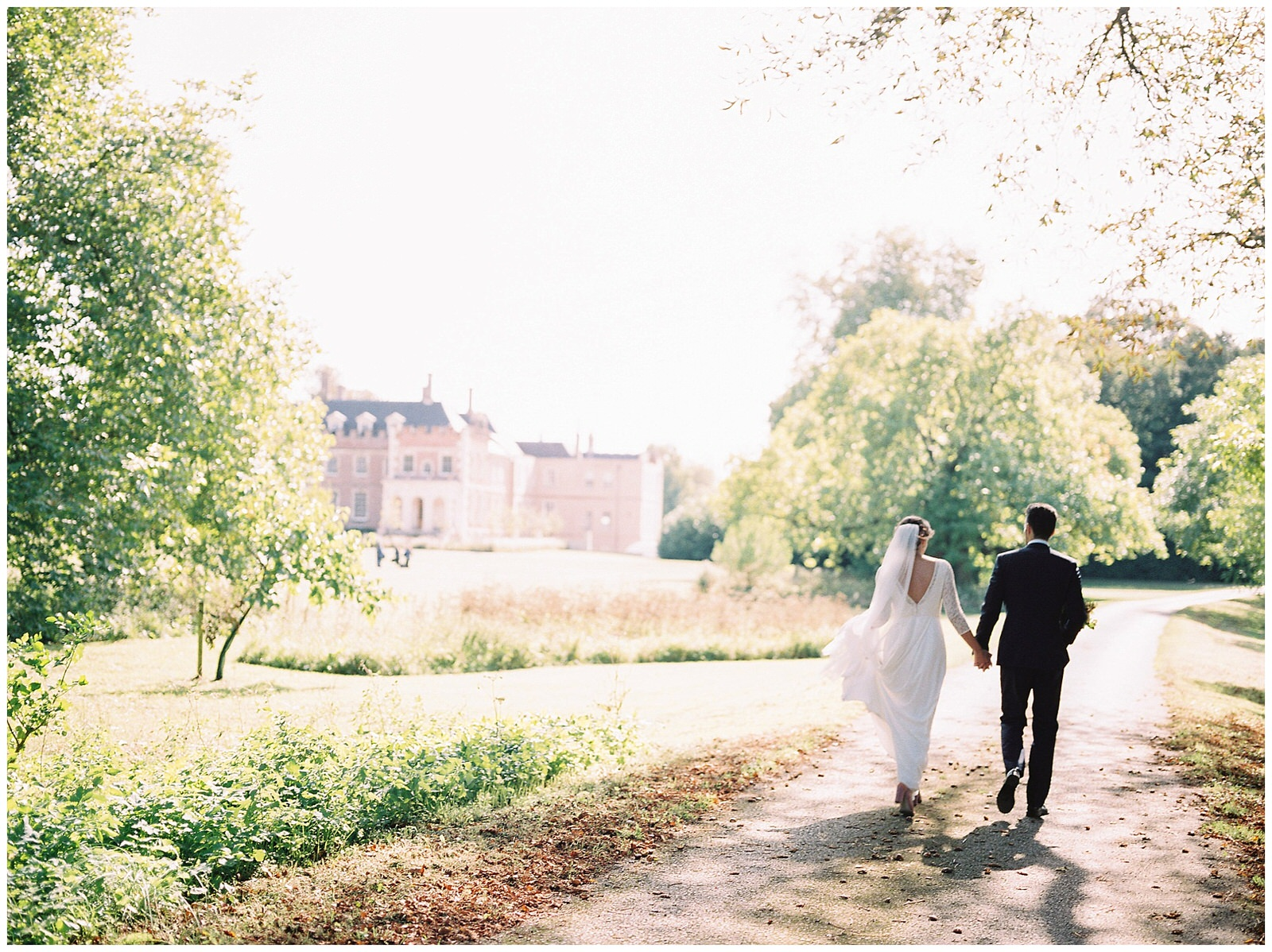 BRIDE AND GROOM WALKING TO ST GILES HOUSE