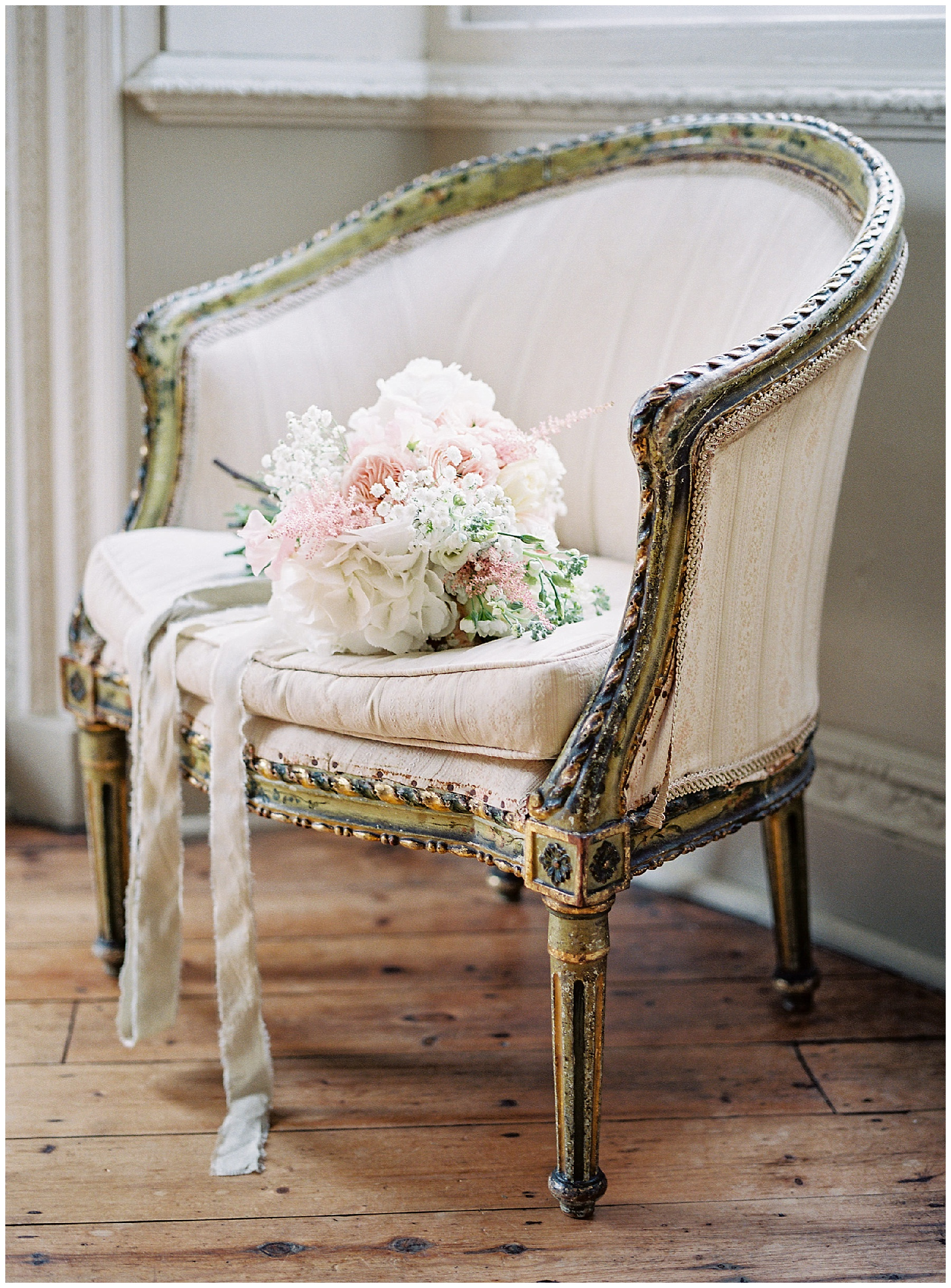 antique chair with bridal bouquet