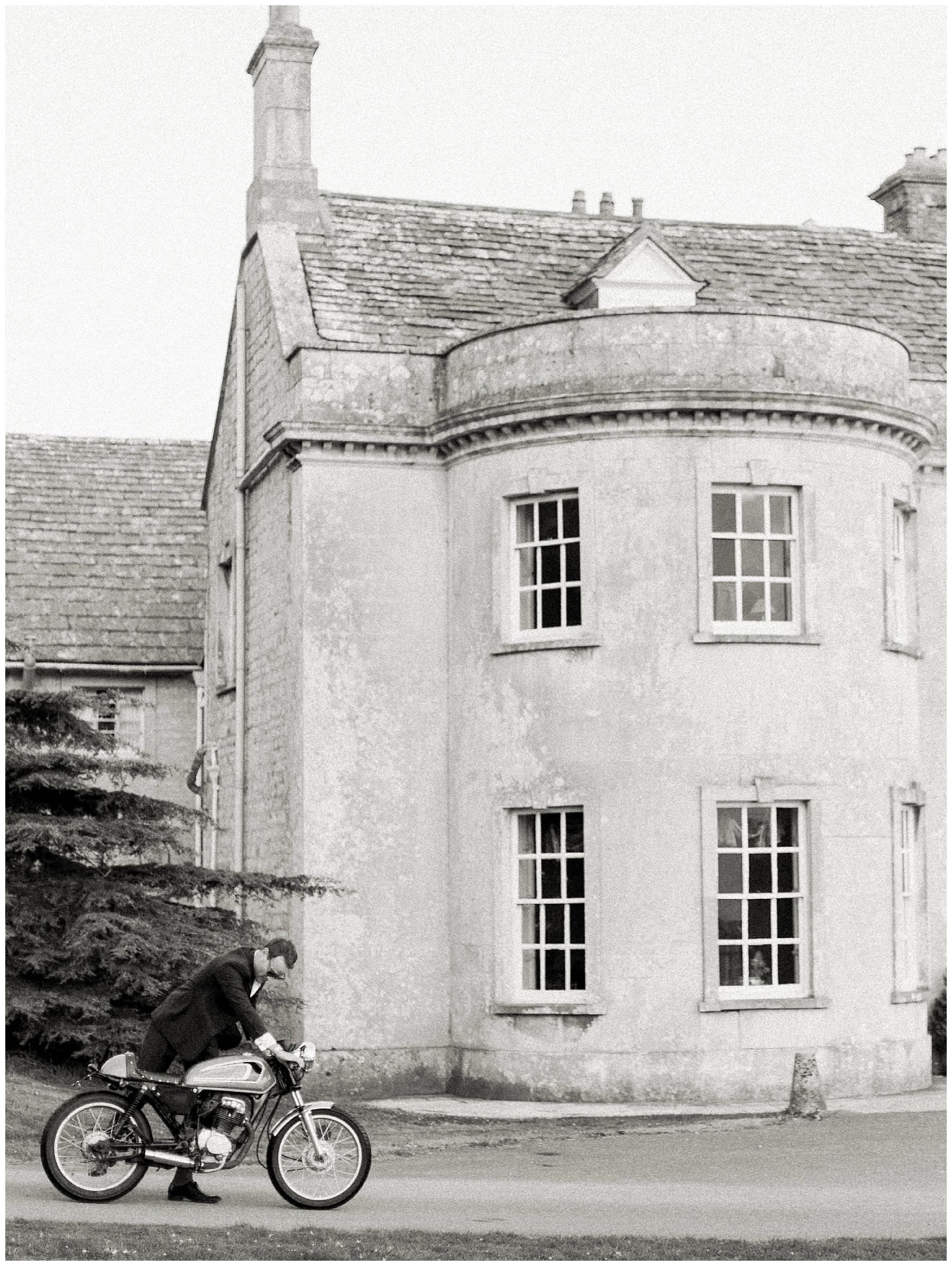 groom on motorbike outside smedmore house wedding
