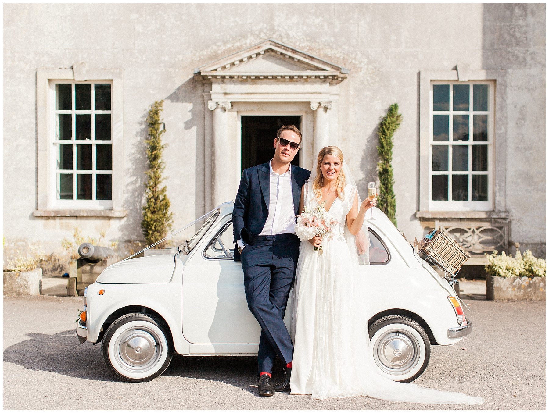 bride and groom beside vintage fiat 500