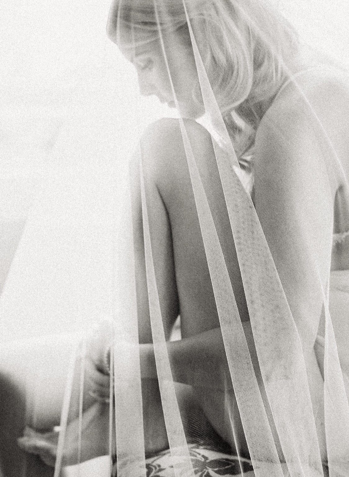 black and white bridal boudoir photo with veil